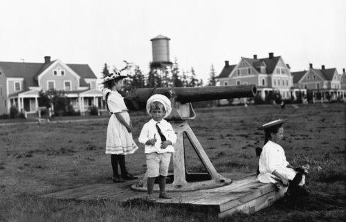 Children playing outside Fort Lawton Officer's Row. Circa 1900. UW Special Collections #UW 4792.