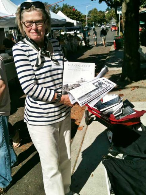 Forbus Hogle participates in the MHS book sales at the Magnolia Farmer's Market in 2014. Photo Monica Wooton.
