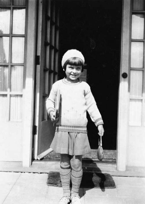 Dale Forbus-Shoemaker is ready for first day of school. No matter their financial situation, her mother always saw to it they had a few new things to wear, making it a special time of year. Living on the Boulevard in the 20s meant classes at Magnolia School. (Courtesy of Forbus Family)
