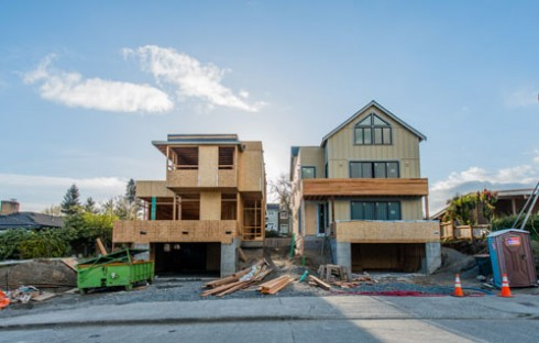 Common today on Magnolia - new homes..two large modern homes where one small WWII ramble once stood.